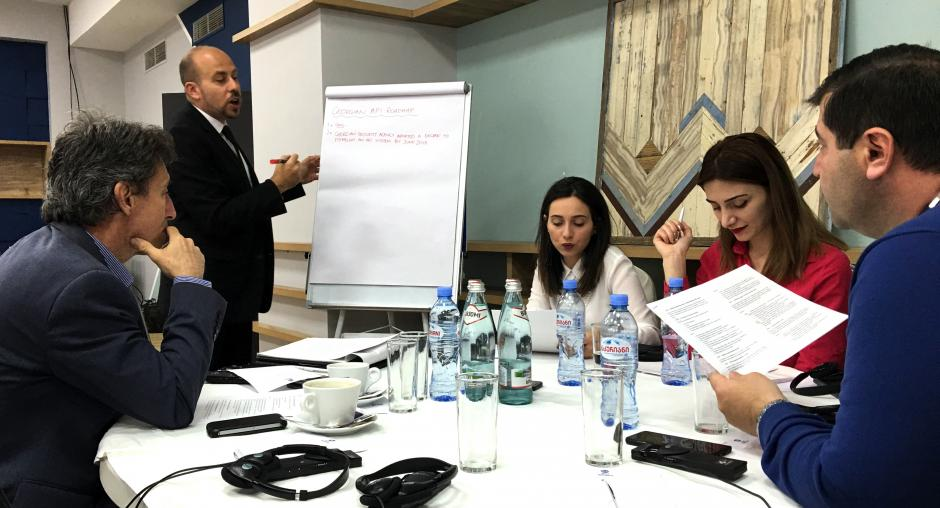 Workshop participants discussing the details of a potential API programme in Georgia, Tbilisi, 19 April 2018. (OSCE/Adrian Carbajo Ariza)